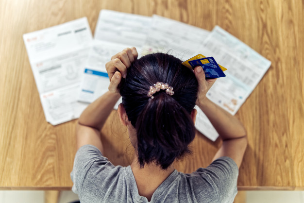 top-view-stressed-young-sitting-asian-woman-hands-holding-head-worry-about-find-money-pay-credit-card-debt-all-l