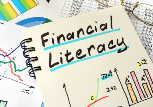 Financial Literacy written on a notepad sheet. Education concept.